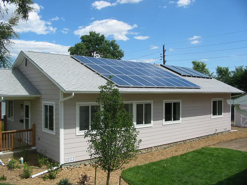 Passive solar design house with PV panels